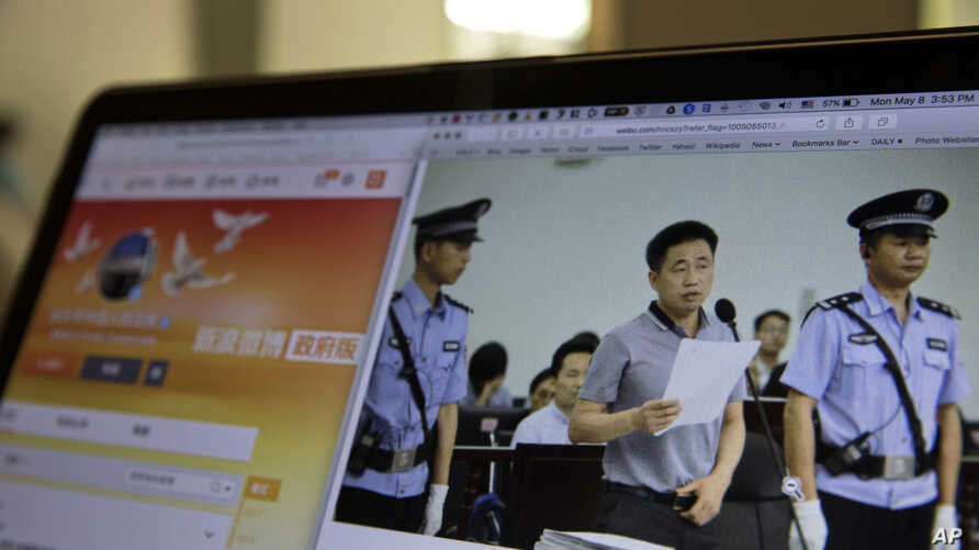 A photo described as the trial showing human rights lawyer Xie Yang which is seen on the social media of the Changshai Intermediate People's Court is displayed on a computer in Beijing, China, Monday, May 8, 2017.