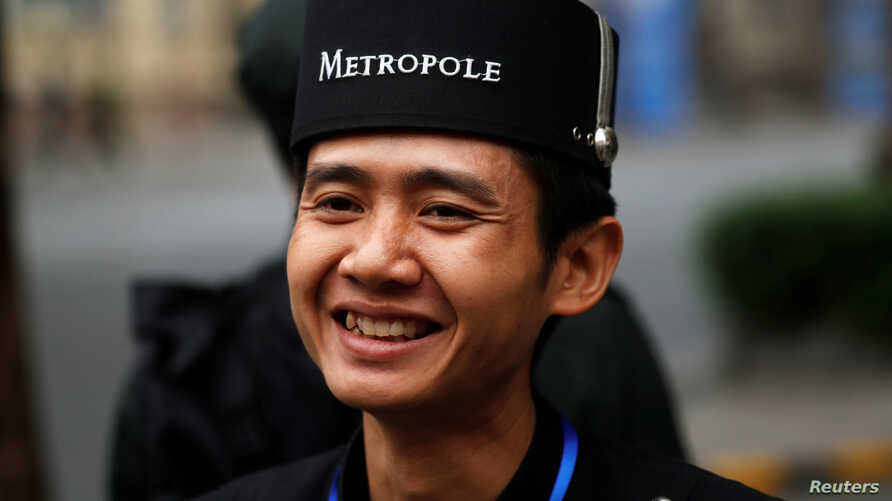 A hotel employee smiles at the Metropole Hotel ahead of the North Korea-U.S. summit in Hanoi, Vietnam, Feb. 27, 2019.