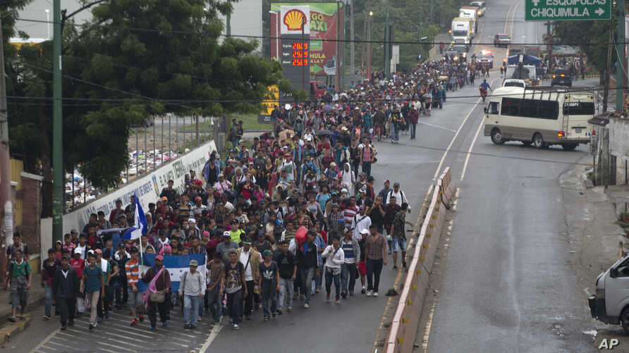 Honduran migrants walking to the U.S. start their day departing Chiquimula, Guatemala, Oct. 17, 2018. The group of more than 2,000 Honduran migrants hit the road in Guatemala again, hoping to reach the United States despite President Donald Trump's t