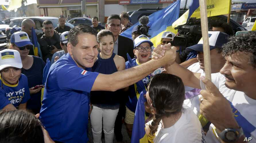 National Restoration Party presidential candidate Fabricio Alvarado greets supporters during a rally in San Jose, Costa Rica, March 31, 2018.