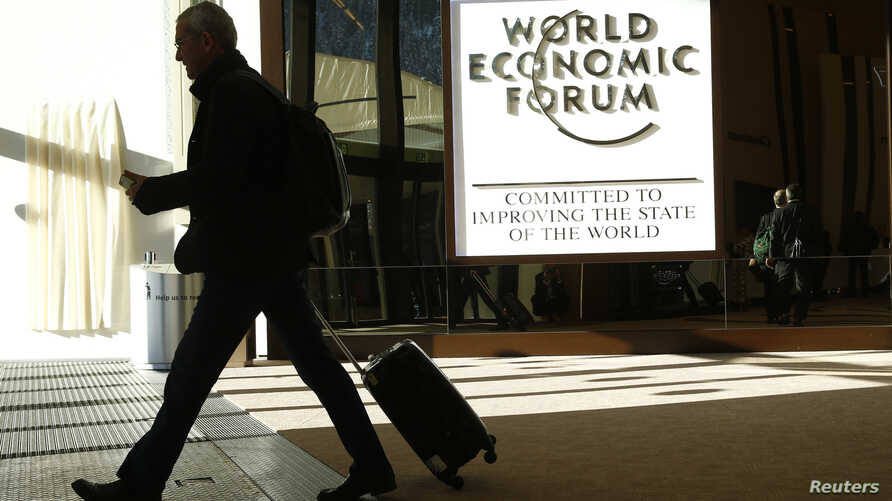 An attendee leaves the Congress Hall during the World Economic Forum (WEF) annual meeting in Davos, Switzerland, Jan. 20, 2017.
