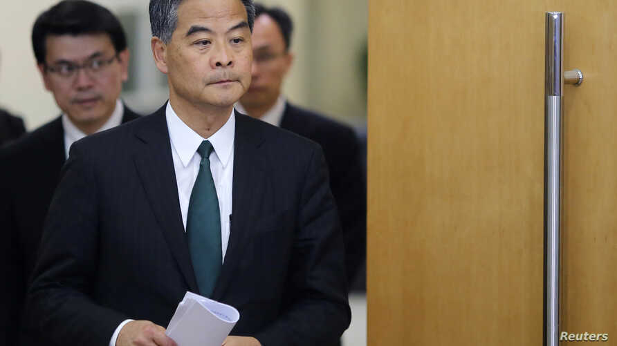 FILE - Hong Kong Chief Executive Leung Chun-ying arrives at a news conference which was held as part of the National People's Congress, the country's parliament, in Beijing, March 6, 2015.