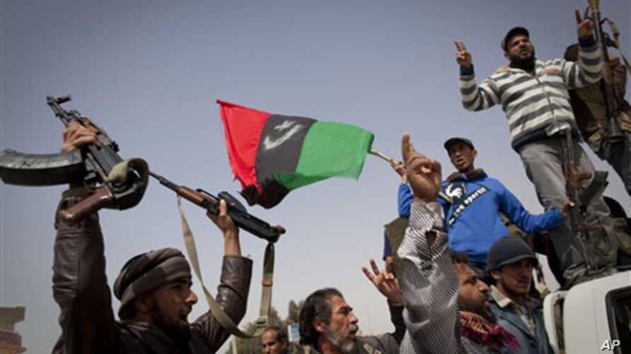 Rebels jubilate after taking the city of Ajdabiya, south of Benghazi, eastern Libya, March 26, 2011