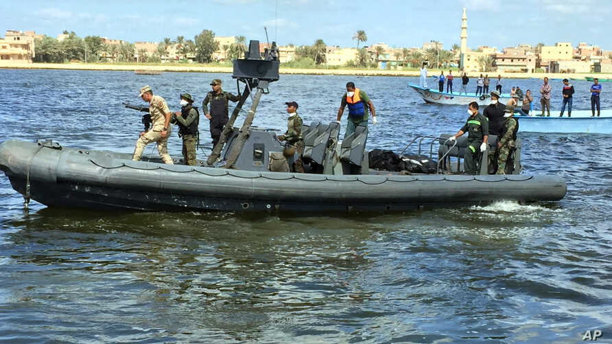 Egyptian coast guard and rescue workers bring ashore bodies recovered from a Europe-bound boat that capsized off Egypt's Mediterranean coast last week, in Rosetta, Egypt, Sept. 27, 2016.