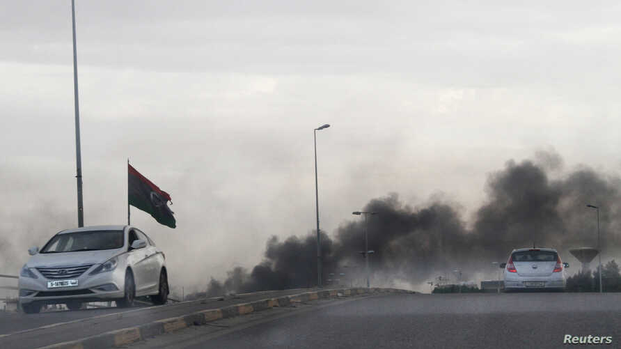 Smoke rises during heavy clashes between rival factions in Tripoli, Libya, May 27, 2017.