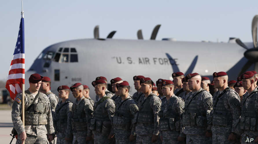 FILE - Members of the U.S. Army 173rd Airborne Brigade attend a welcome ceremony upon their arrival at a Lithuanian air force base in Siauliai, Lithuania, April 26, 2014. Troops from the brigade will be among those participating in exercises Rapid Tr...