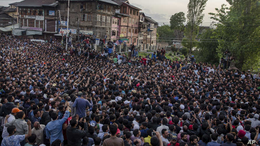 Kashmiri Muslims carry the body of Fayaz Ahmad Hamal, a local rebel, during his funeral procession in Srinagar, Indian-controlled Kashmir, May 5, 2018. Indian troops killed three suspected rebels Saturday in the main city in Indian-controlled Kashmi
