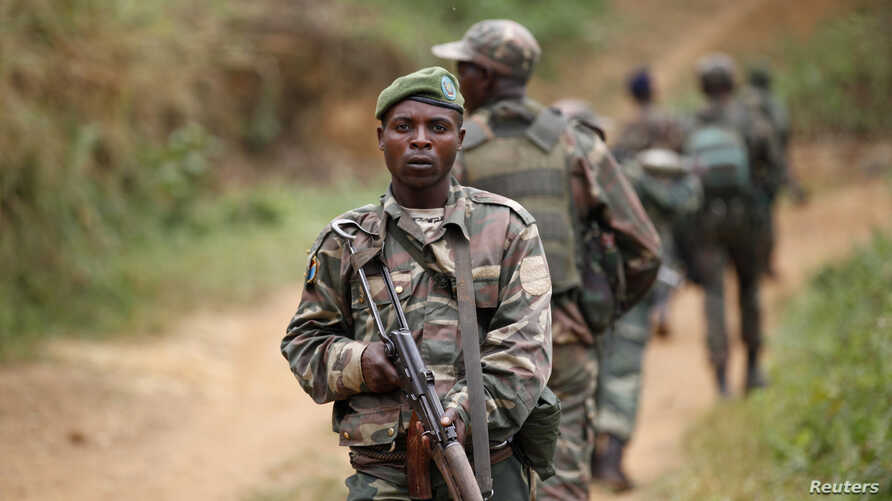 FILE - Democratic Republic of the Congo troops patrol against the Allied Democratic Forces and the National Army for the Liberation of Uganda  rebels near Beni in North-Kivu province, Dec. 31, 2013.
