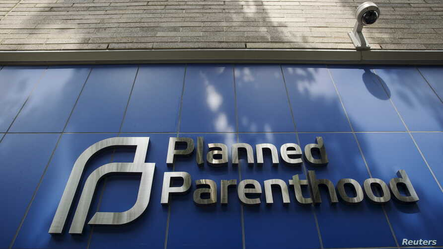 FILE - A sign is pictured at the entrance to a Planned Parenthood building in New York.