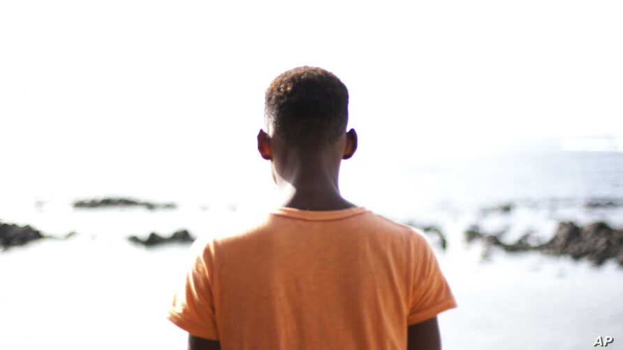 FILE - Alhaji, who is gay and whose last name has been withheld for his safety, poses for a picture at La Pointe des Almadies, in Dakar, Senegal.