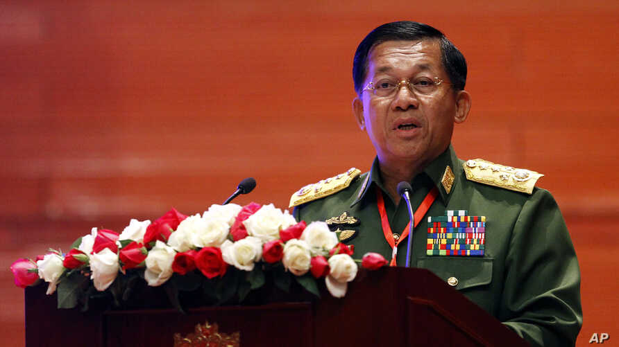 Myanmar's Army Commander Senior Gen. Min Aung Hlaing speaks during a ceasefire agreement at the Myanmar International Convention Center in Naypyitaw, Feb. 13, 2018.