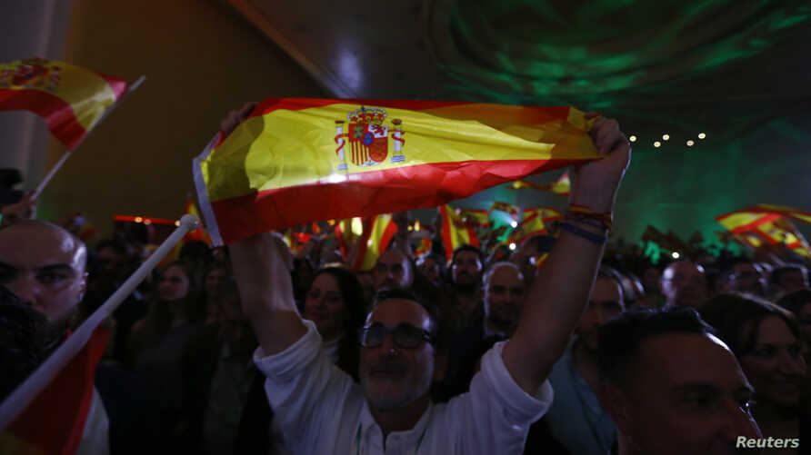 Supporters of Spain's far-right VOX party celebrate results after Andalusian regional elections in Seville, Spain, Dec. 2, 2018.