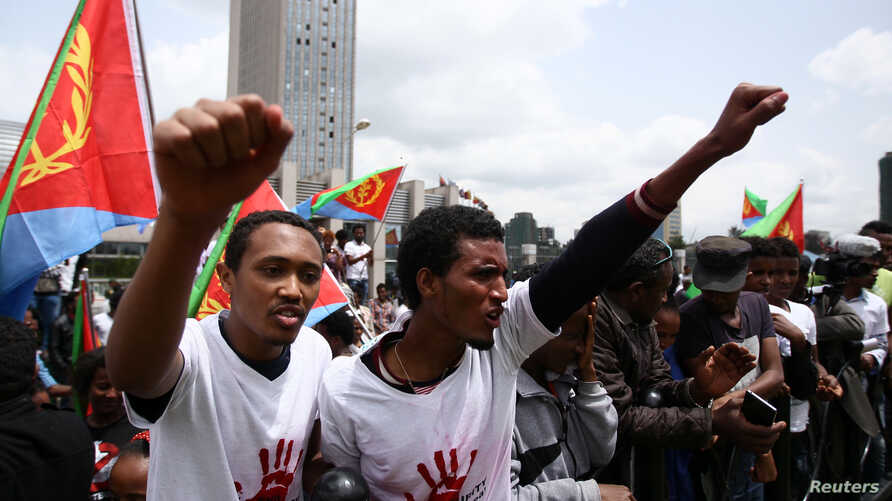 FILE -  Eritrean refugees chant slogans as they participate in a demonstration in support of a U.N. human rights report accusing Eritrean leaders of crimes against humanity in front of the Africa Union headquarters in Ethiopia's capital Addis Ababa,