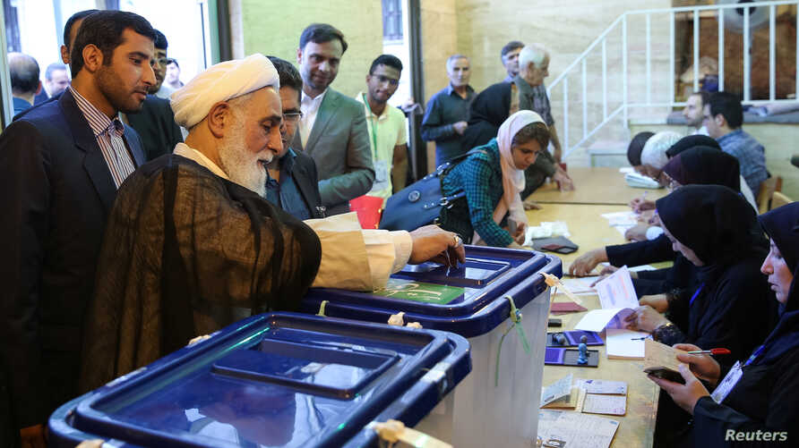 FILE - Ali Akbar Nategh-Nouri casts his vote into a ballot box during the presidential election in Tehran, Iran, May 19, 2017. (TIMA via Reuters)