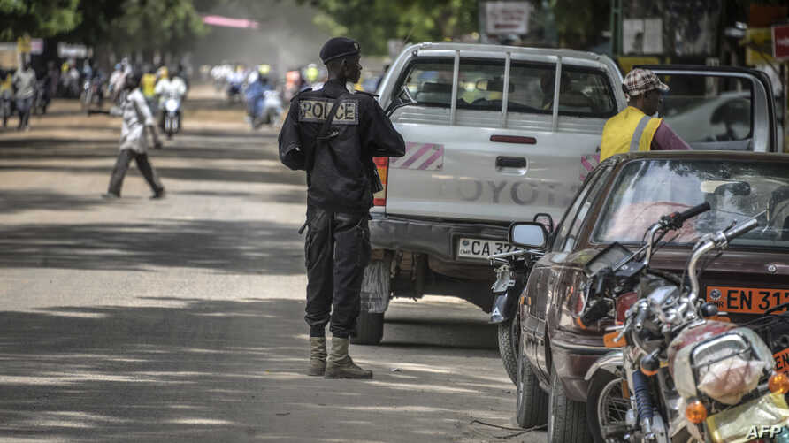 FILE - A Cameroonian policeman patrols in Maroua, in the extreme northern province, west of the Nigerian border.
