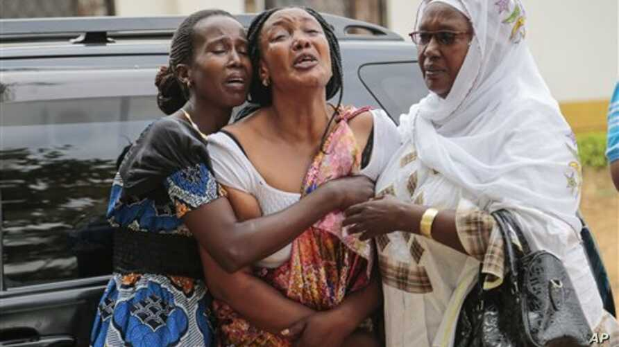 Relatives and friends  grieve during the funeral of Patrick Ndikumana, Friday, July 3, 2015, in Bujumbura, Burundi. According to relatives Ndikumana was killed in the police attack in Jabe neighborhood last week. A U.N. observer mission concluded Thu...