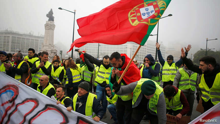 """Protesters are seen during a demonstration by the """"yellow vests"""" movement in Lisbon, Portugal, December 21, 2018."""