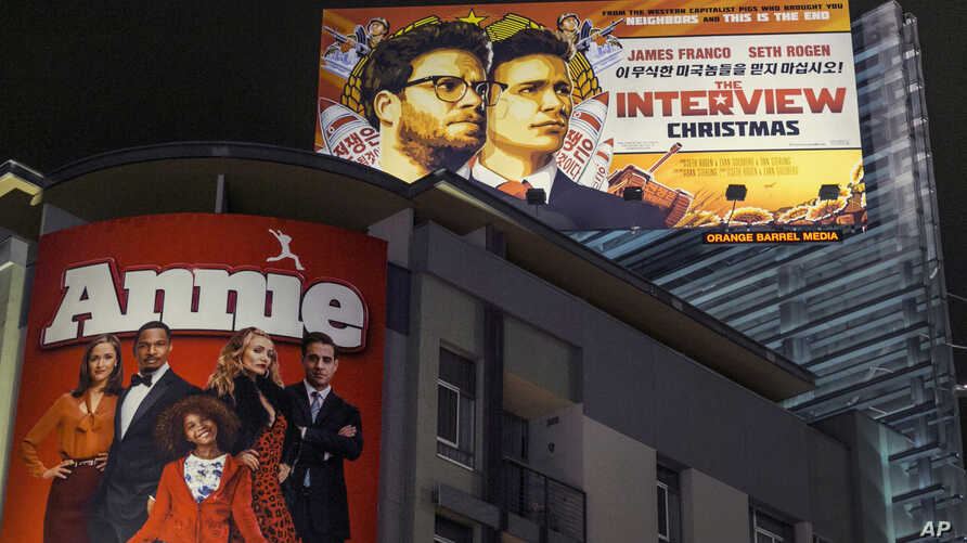 """A banner for Sony Pictures' """"The Interview,"""" a film whose release was recently canceled, is posted high outside Arclight Cinemas in Hollywood, California, Dec. 17, 2014."""