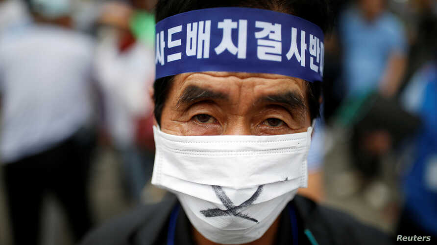 A Seoungju resident takes part in a protest against the government's decision on deploying a U.S. THAAD anti-missile defense unit in Seongju, in Seoul, South Korea, July 21, 2016.