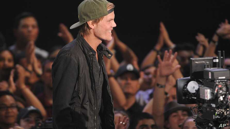 FILE - Avicii accepts the award for EDM song of the year at the iHeartRadio Music Awards at the Shrine Auditorium on May 1, 2014, in Los Angeles.