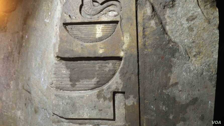 A close-up of the carvings found on the colossus discovered few days ago that almost certainly depicts Psamtik I in the Egyptian Museum Cairo, March 14, 2017. (H. Elrasam/VOA)