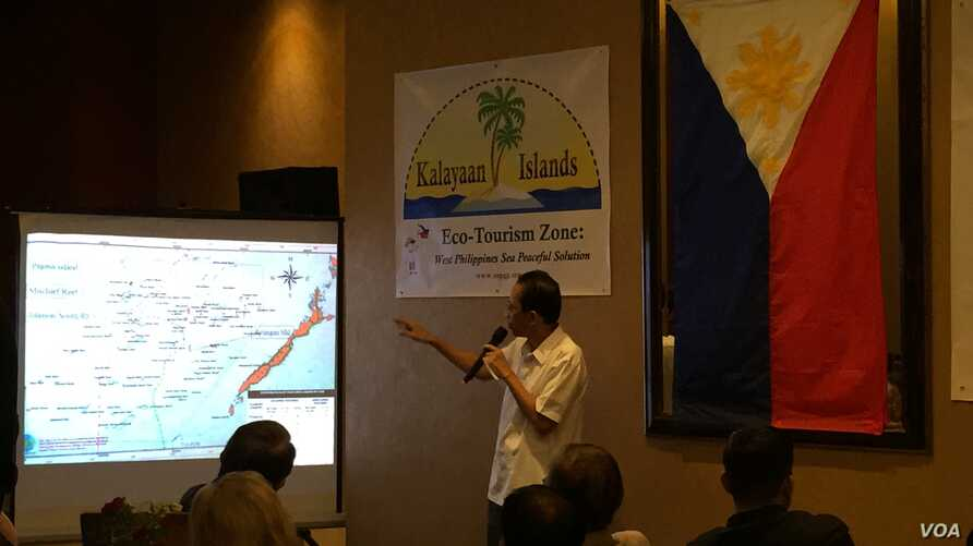 """Mayor Eugenio Bito-onon of the Kalayaan Group of Islands, the Philippines-controlled outcroppings in the Spratly Islands, points out the Philippines' claims in the Spratlys during a fundraising dinner to gain support for a proposed """"ecotourism zone"""""""