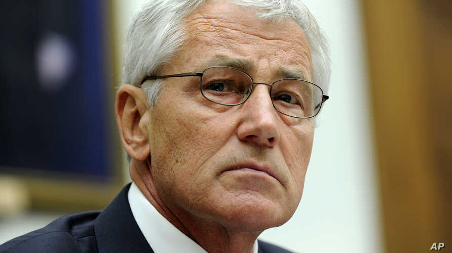 Defense Secretary Chuck Hagel listens to opening statements prior to testifying on Capitol Hill in Washington,  June 11, 2014, before the House Armed Services Committee.