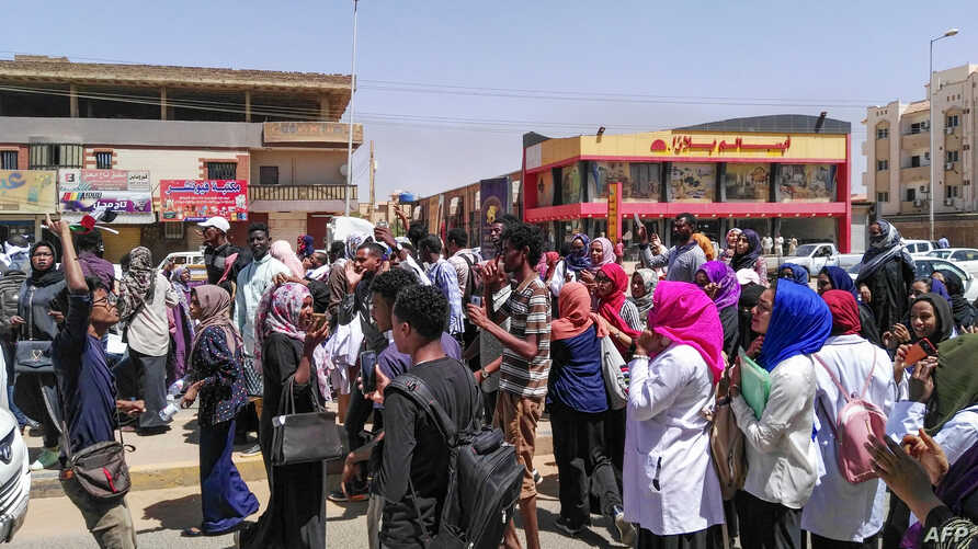 "Protesters shout ""freedom, peace, justice""  during an anti-government demonstration in Khartoum, Sudan, March 18, 2019."