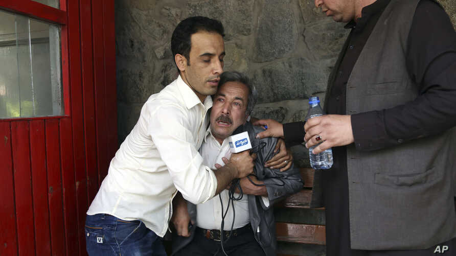A man cries at a hospital after he lost his Journalist son in explosions in Kabul, Afghanistan, Monday, April 30, 2018.