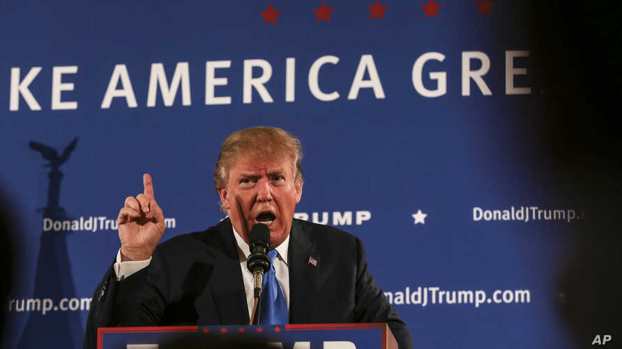 Republican presidential candidate Donald Trump gestures while speaking at a town hall meeting at Atkinson Country Club in Atkinson, New Hampshire, Oct. 26, 2015.