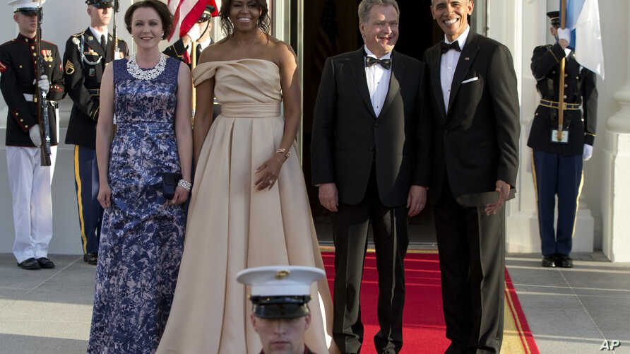 President Barack Obama and first lady Michelle Obama stand with Finnish President Sauli Niinisto his wife Jenni Haukio as they arrive at the North Portico of the White House in Washington, Friday, May 13, 2016, for a State Dinner.