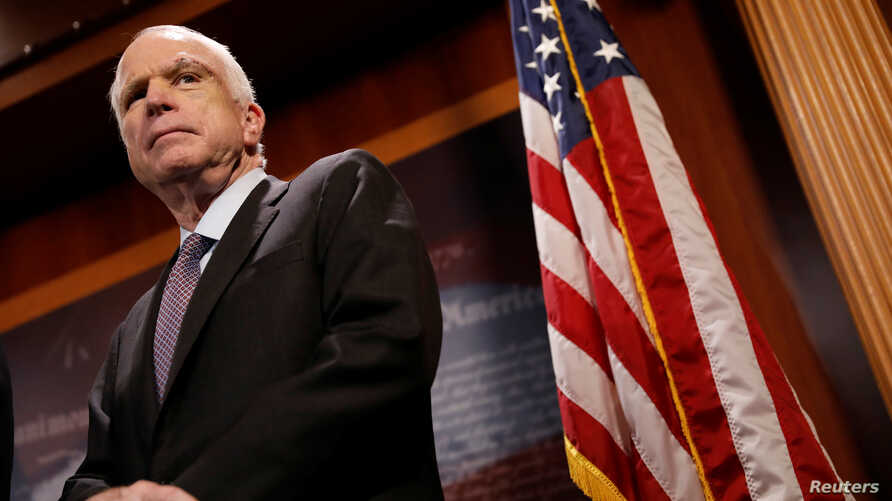 """Senator John McCain looks on during a press conference about his resistance to the so-called """"Skinny Repeal"""" of the Affordable Care Act on Capitol Hill in Washington, U.S., July 27, 2017."""