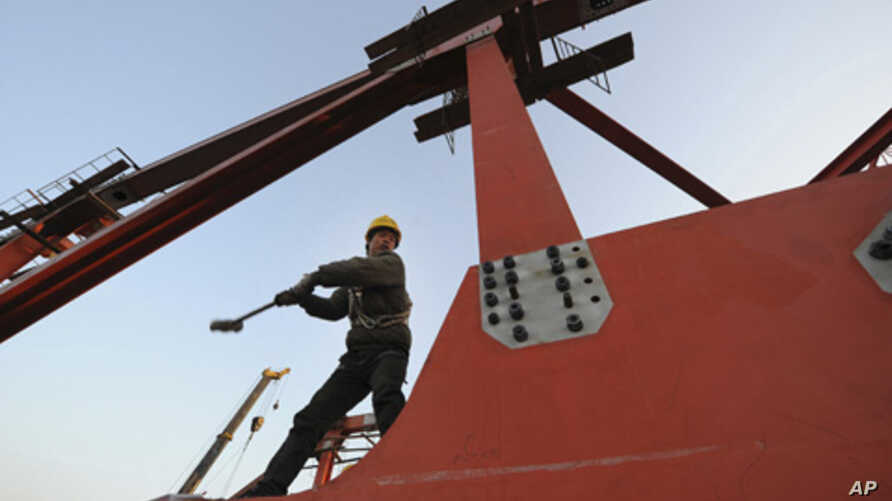 A laborer works at a high-speed railway viaduct construction site in Hefei, Anhui province, China, Jan. 4, 2011.