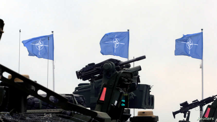 NATO flags flutter during the final day of NATO Saber Strike exercises in Orzysz, Poland, June 16, 2017.