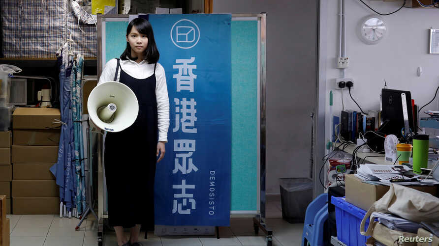FILE - Student activist Agnes Chow poses before her campaign to join the Legislative Council in the March election, at the Demosisto party office in Hong Kong, Dec. 8, 2017.