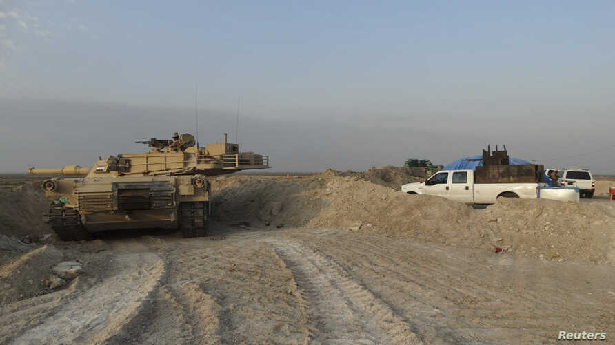 Iraqi security forces military vehicles are seen during an intensive security deployment against Islamic State militants in the town of Amriyat al-Falluja,in Anbar province, Oct. 31, 2014.