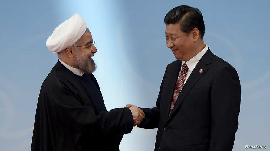 Iran's President Hassan Rouhani, left, shakes hands with his Chinese counterpart Xi Jinping at the fourth Conference on Interaction and Confidence Building Measures in Asia summit in Shanghai, May 21, 2014. The two will meet again on the sidelines o