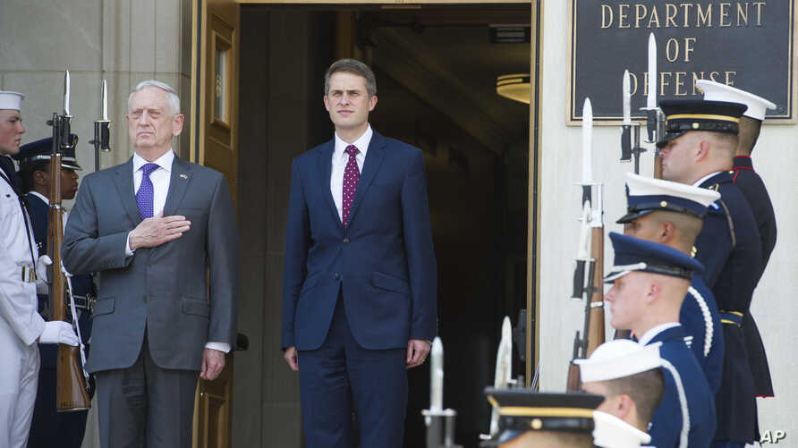 Secretary of Defense Jim Mattis, left, and UK Secretary of State for Defense Gavin Williamson stand for the National Anthem during an arrival ceremony prior to their meeting at the Pentagon, Aug. 7, 2018.