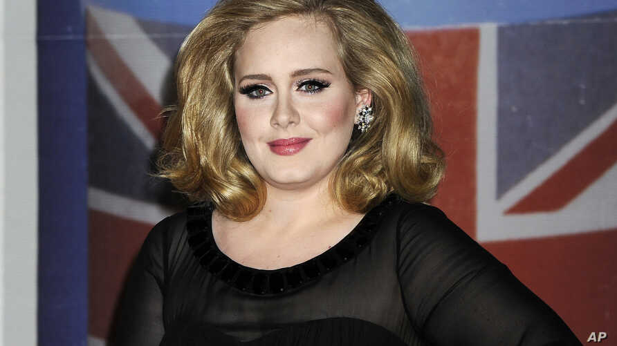FILE - Adele arrives for the Brit Awards.