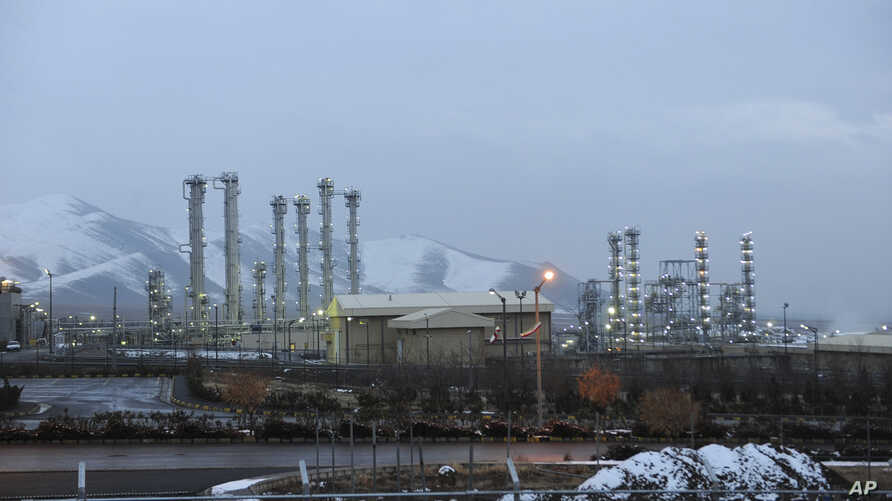 FILE - In this Jan. 15, 2011 file photo, Iran's heavy water nuclear facility is backdropped by mountains near the central city of Arak, Iran.