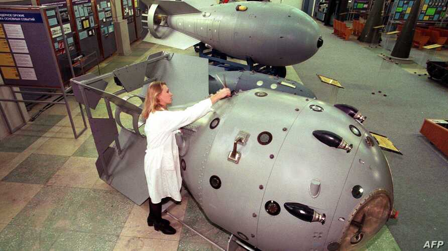 FILE - A museum staff member at the Russian Federal Nuclear Center cleans the first Soviet nuclear bomb, tested in 1949, in Sarov, Oct. 19, 1997. Employees at the facility were detained after trying to mine bitcoin, Russian news agencies reported Fri