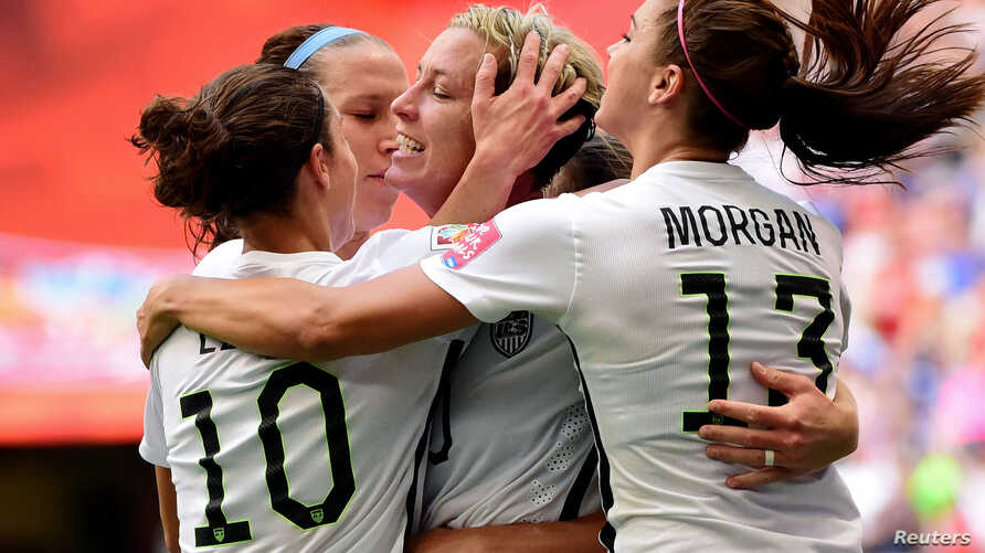 United States forward Abby Wambach (20) is congratulated by midfielder Carli Lloyd (10) and forward Alex Morgan (13)\ after scoring against Nigeria during the first half in a Group D soccer matc, June 16, 2015.