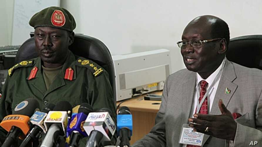 South Sudanese Minister of Information Barnaba Benjamin Marial, right, and Military Spokesman Philip Aguer brief the median Juba, south Sudan about recent fighting between Sudanese and South Sudanese forces along the north-south border, FILE March 27