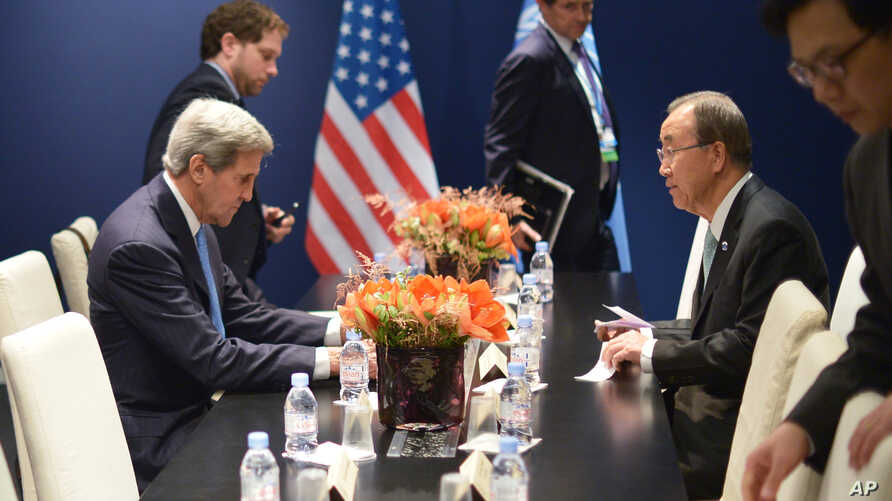 U.S. Secretary of State John Kerry, left, and United Nations Secretary-General Ban Ki-moon meet on the sidelines of the COP 21 United Nations conference on climate change, in Le Bourget, on the outskirts of Paris, Dec. 11, 2015.