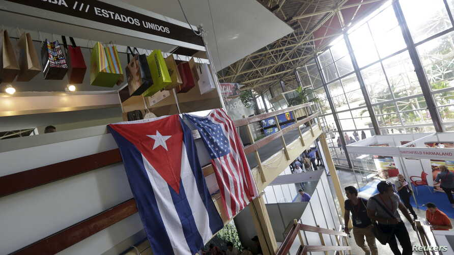 U.S. and Cuban flags hang on a wall at the U.S pavilion during the Havana International Fair (FIHAV), Havana, Cuba, Nov. 2, 2015.