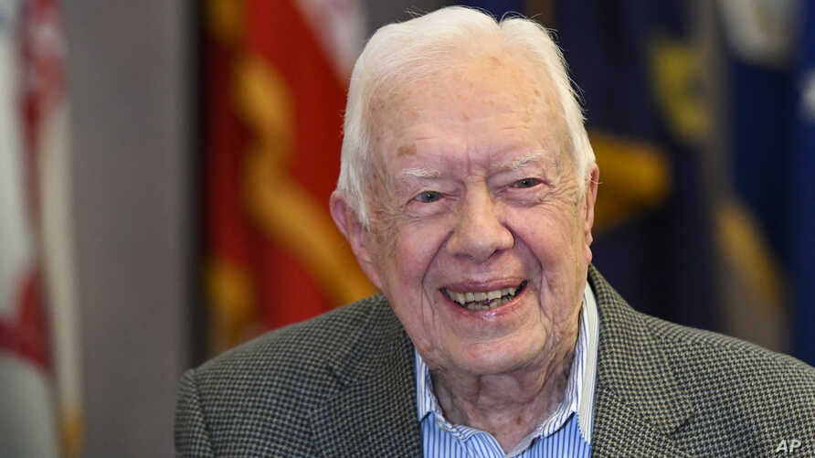 FILE - Former President Jimmy Carter, 93, sits for an interview before a book signing in Atlanta, April 11, 2018.