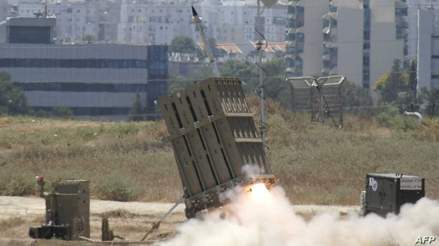 "A missile is launched by an ""Iron Dome"" battery, a short-range missile defence system designed to intercept and destroy incoming short-range rockets and artillery shells, on July 11, 2014 in the southern Israeli city of Ashdod. Three Gaza rockets wer"