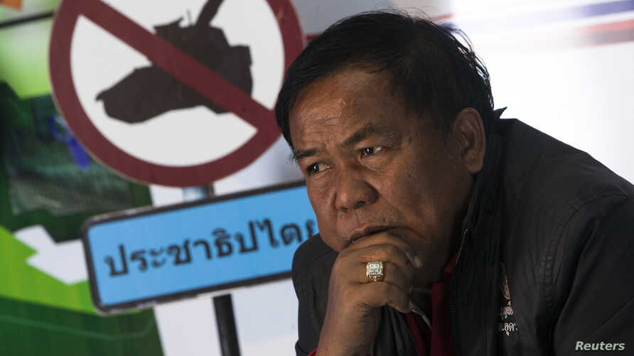 "FILE - Kwanchai Praipana, a pro-government ""red shirt"" leader, is seen during an interview with Reuters at a radio station he owns in Udon Thani, Jan. 21, 2014."