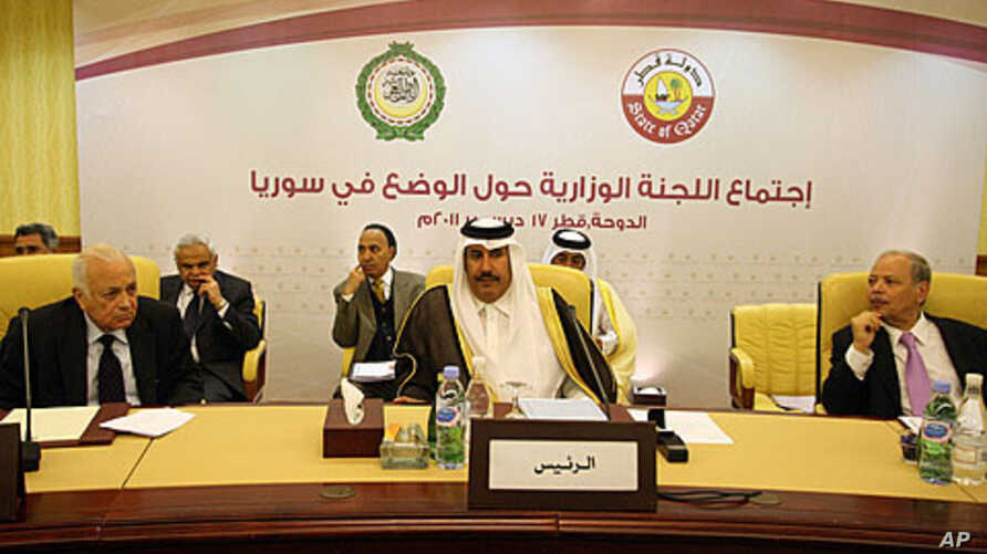Arab League Secretary General, Nabil Elarabi, left, Qatari Prime Minister Sheikh Hamad bin Jassim bin Jabr al-Thani, center, and Ahmed bin Heli, the Arab League's assistant secretary-general for political affairs, during the group's meeting on Syria