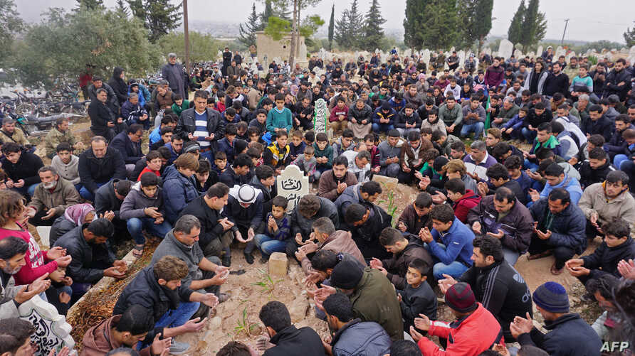 Mourners attend the funeral of Raed Fares and Hammoud al-Jneid in the village of Kafranbel in the northwestern province of Idlib, Nov. 23, 2018. Two activists critical of the regime and jihadists were gunned down Friday in Syria's last major rebel ba